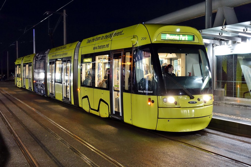 209 arrives with a service for Phoenix Park. This tram is carrying an advertising livery for various NET promotions.