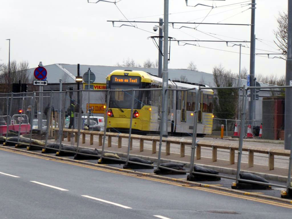 Heading away to the event at the Trafford centre we see 3105 passing through the Village Circle roundabout before entering the roadside alignment on Village Way. (All Photographs by Steve Hyde, 19th December 2019)