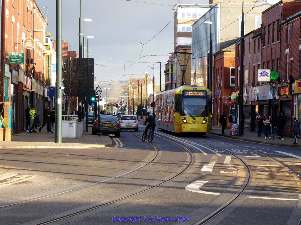 Standing at Oldham King Street stop the photographer captures 3062 approaching on Union Street with a service to East Didsbury. The badly parked car on the left is an example of something that seems fairly common in Oldham.