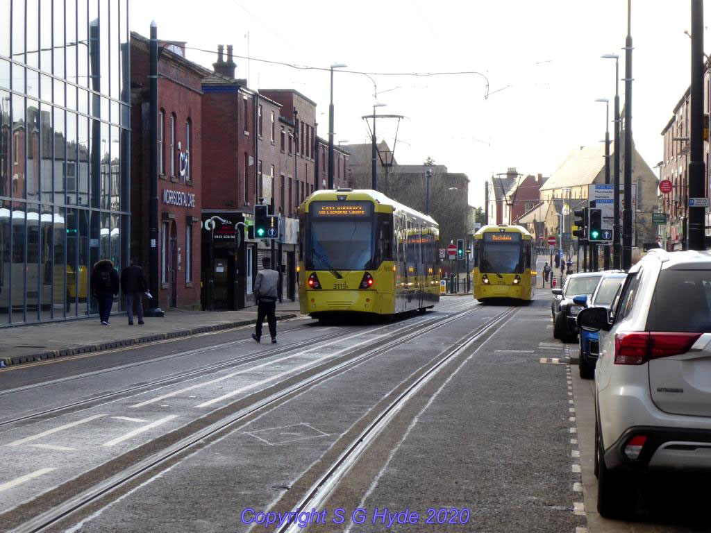 Moving along Union Street and looking back towards King Street we catch 3119 heading for East Didsbury and passing 3114 on an East Didsbury to Rochdale service.