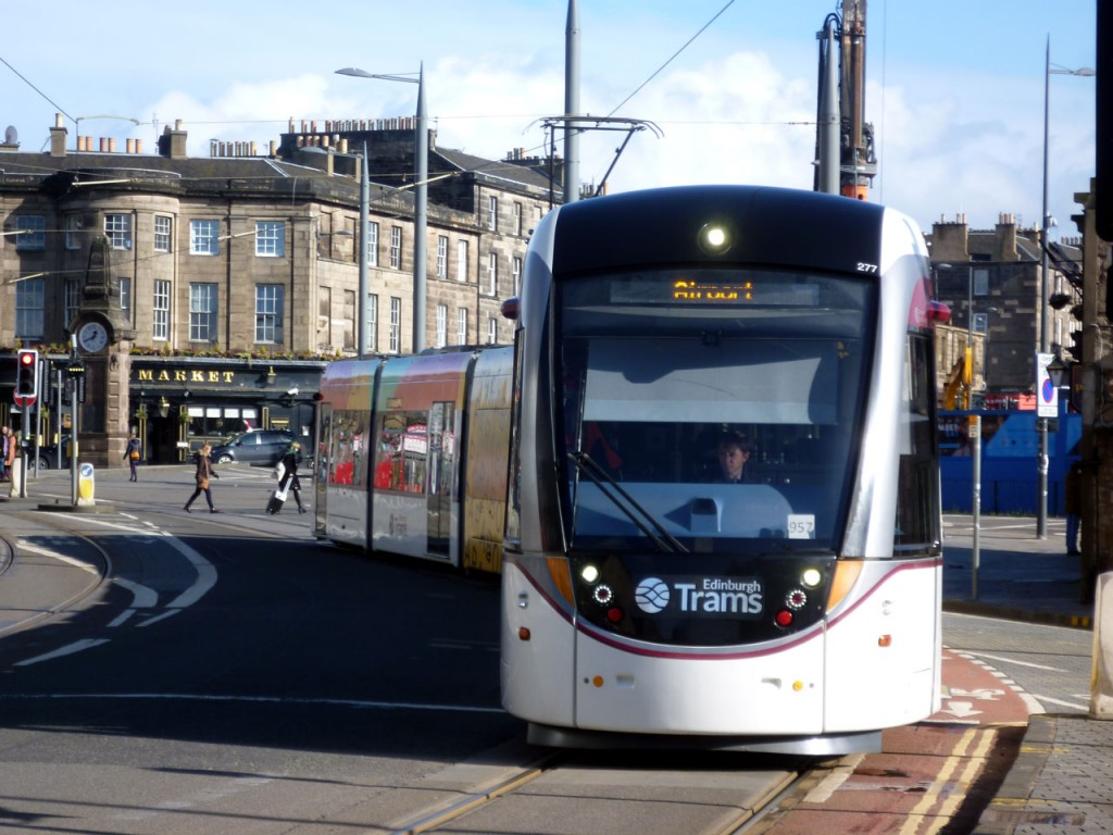 277 is seen here in this photo approaching the stop at Haymarket with a service for the Airport. In the background we can see the Heart of Midlothian War Memorial which commemorates footballers who died during World War I, with 13 of the Hearts team of time enlisting in the 16th Battalion of the Royal Scots only six returned.