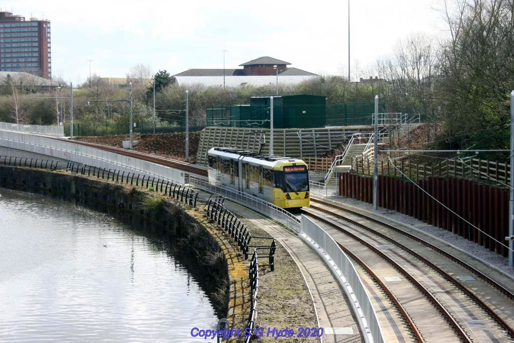 Looking towards Pomona from Trafford Road as 3078 heads for Pomona approaching the ramp up from Wharfside.
