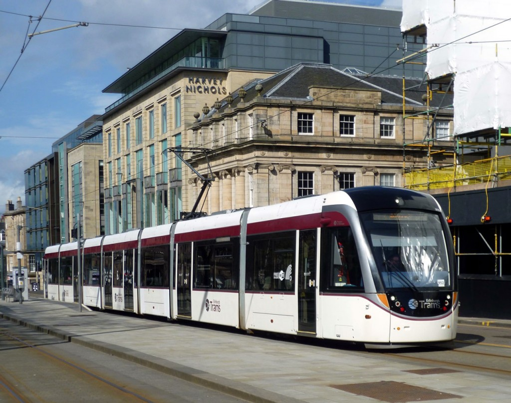 This image shows 270 just pulling away from the stop with a service from York Place to the Airport. The tram is in plain fleet livery and the modern Harvey Nicholls building dominates the background. (Photograph by Roy Calderwood, 6th April 2020)
