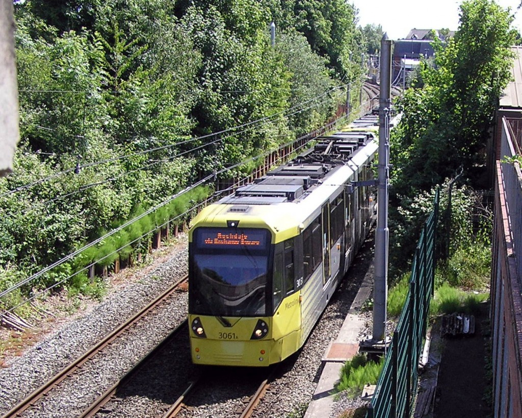 This image shows one of those double trams led by M5000 3061 as it passes under Brantingham Road bridge having just departed from Chorlton with a service heading to Rochdale. With reduced services running the intermediate Shaw & Crompton is not currently in operation. (Photograph by Keith Chadbourne, 31st May 2020)