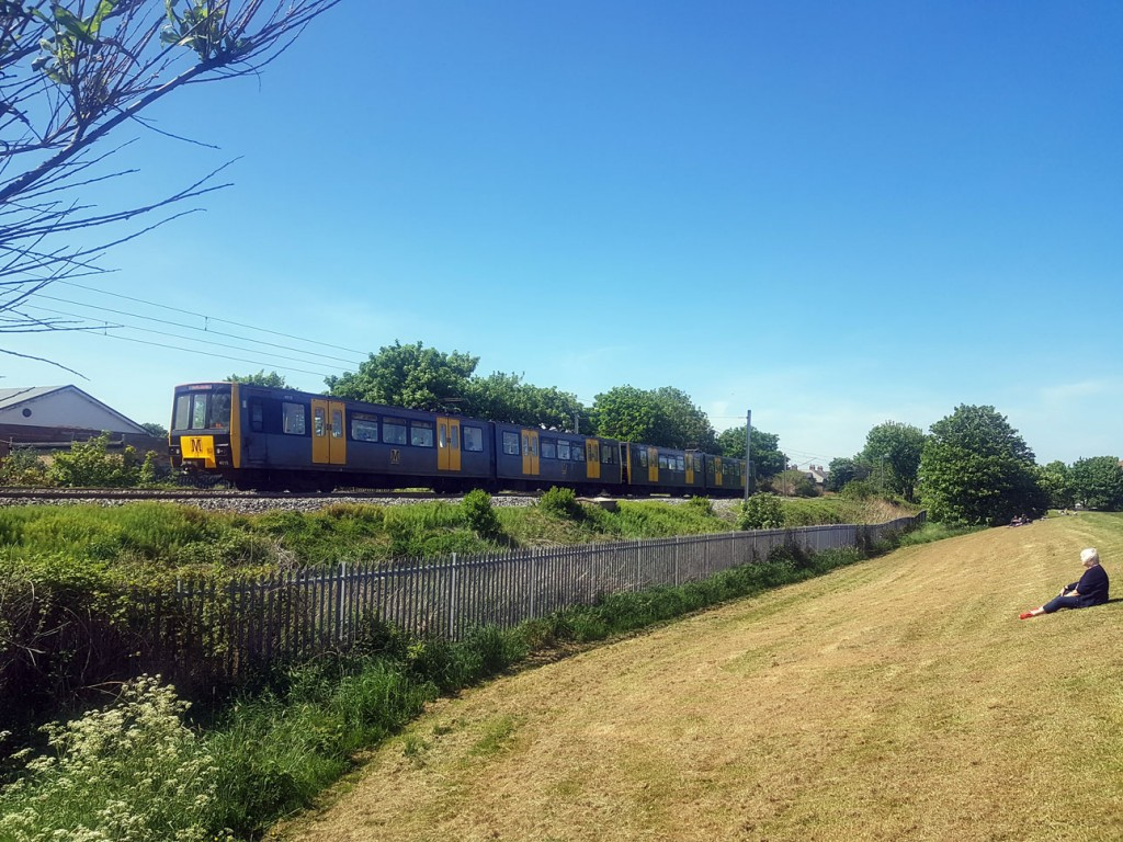 With clear blue skies and warm weather we see 4015 leading a standard double-unit away from Tynemouth passing the large green by the Aquarium in the town. The units are off to Cullercoats and Whitley Bay. (Photograph by David Maxwell, 20th May 2020)