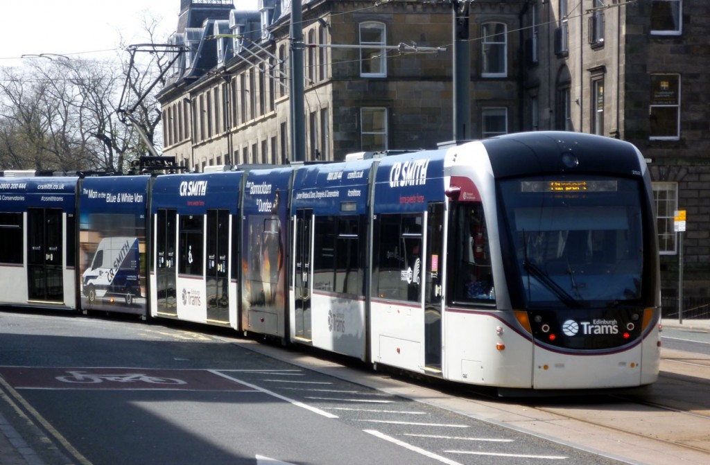 This photo shows 252 – one of the trams to retain C R Smith adverts – heading away from the camera and York Place as it curves into North Saint Andrew Street with a service for the Airport on 23rd April 2020. (Photograph by Roy Calderwood, 23rd April 2020)