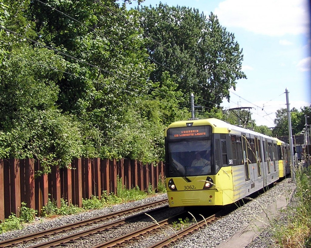 The photo here shows 3062 at the head of a service to Rochdale which has just departed from the stop at Chorlton. (Photograph by Keith Chadbourne, 1st June 2020)